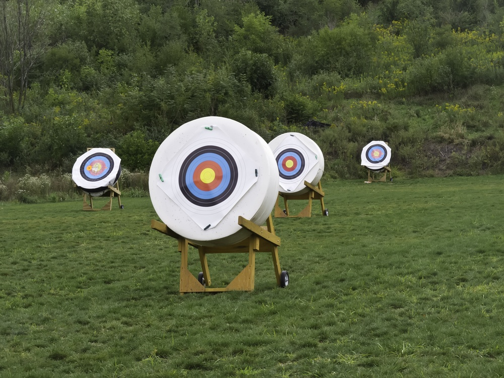 Four movable targets at back of archery range.jpeg