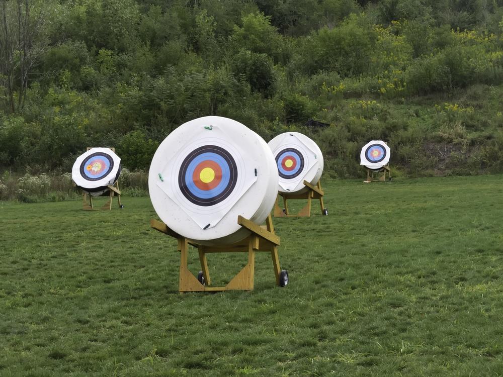 Four movable targets at back of archery range.jpeg